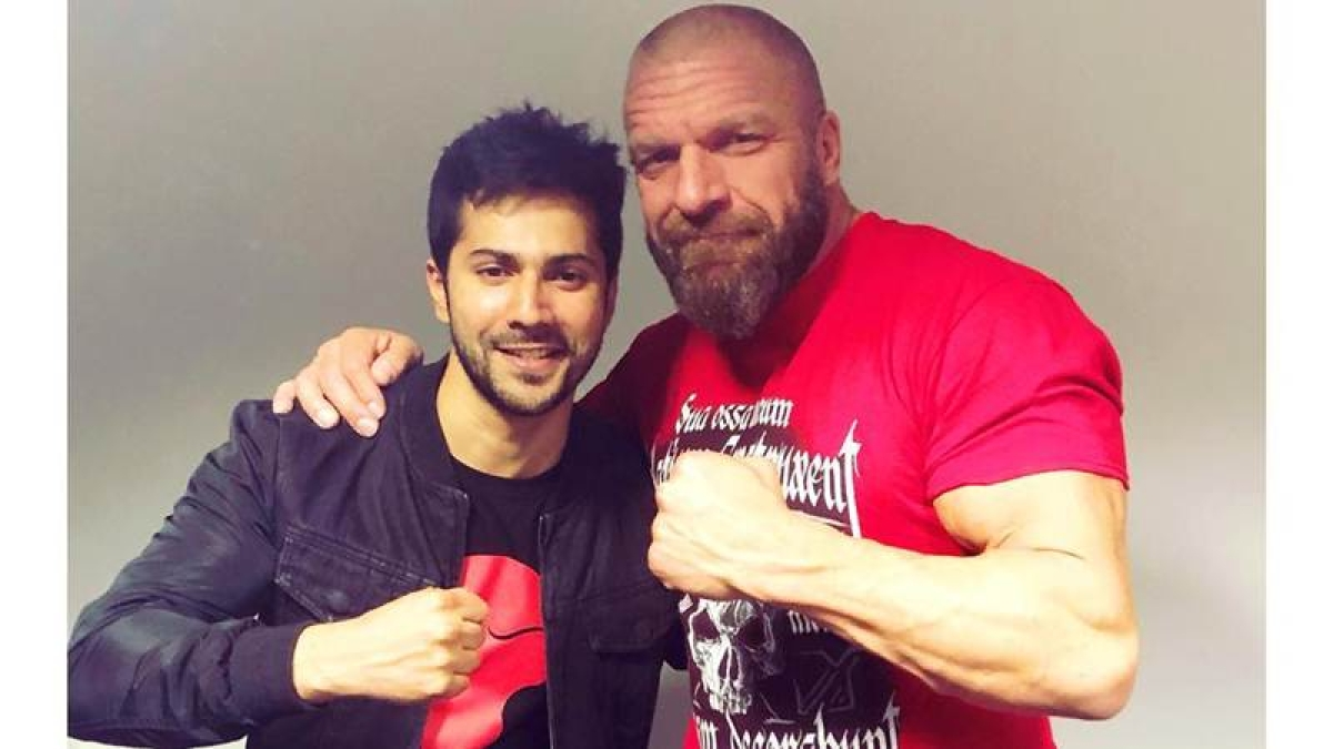 In pictures: Varun Dhawan meets Triple H, Jinder Mahal at WWE India event