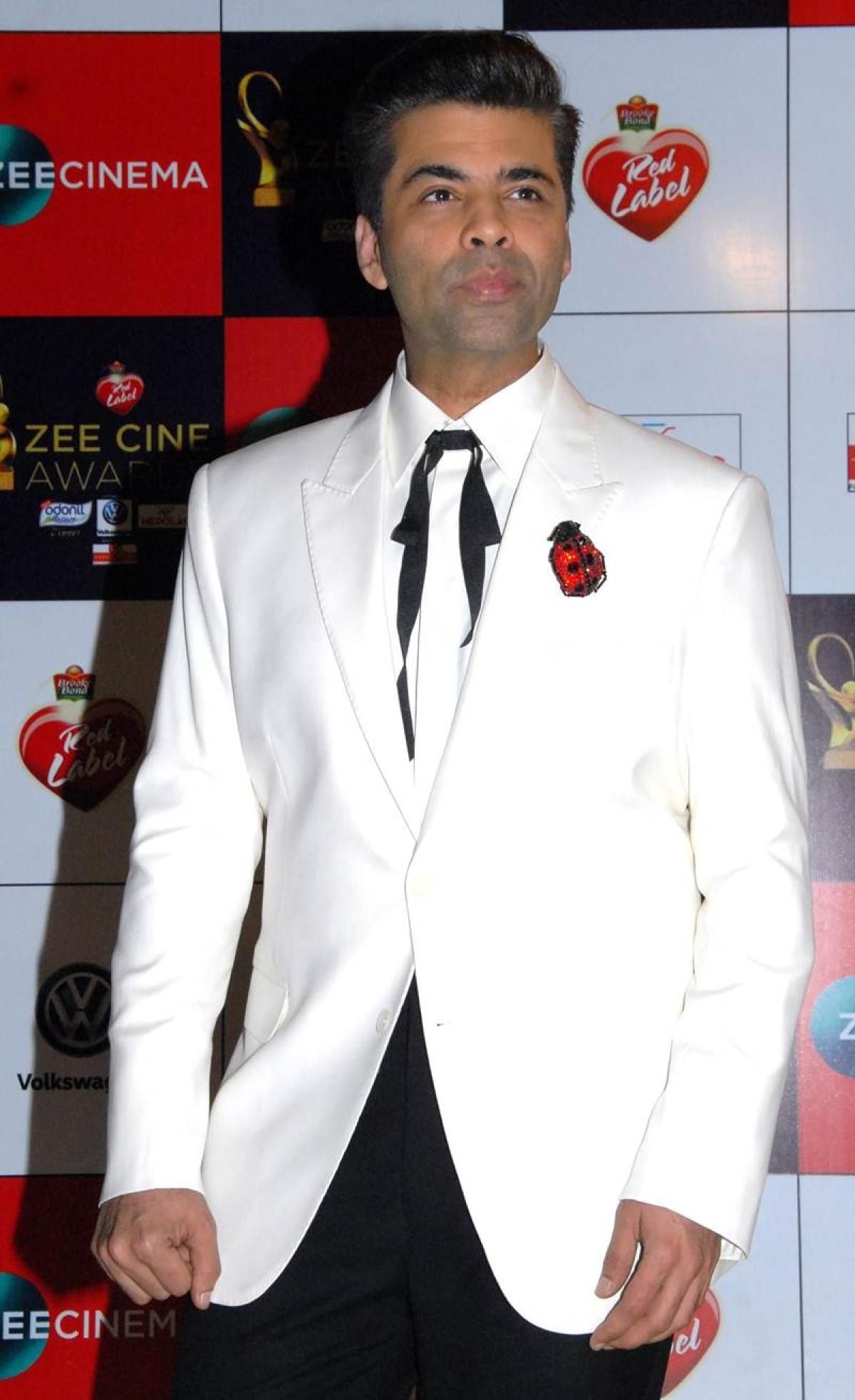 """Don't want my children to grow up on film sets"", says Karan Johar"