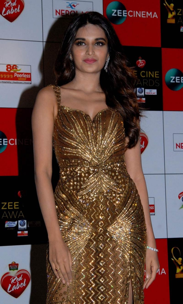 Niddhi Agerwal attends the 'Zee Cine Awards 2018' ceremony in Mumbai on December 19, 2017. / AFP PHOTO / Sujit Jaiswal
