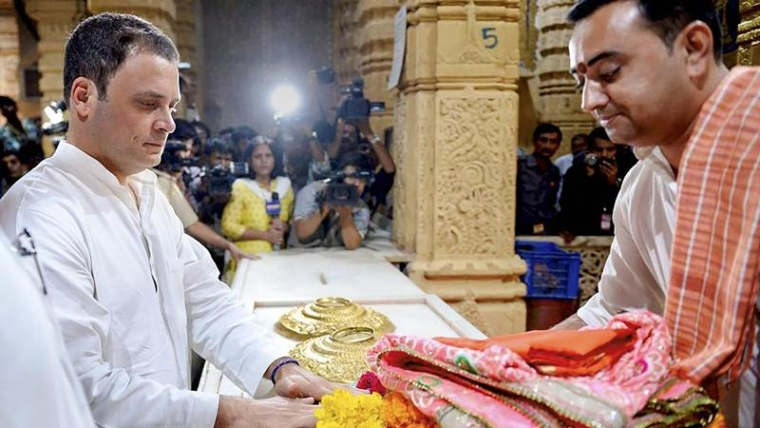 Congress President Rahul Gandhi offering prayers at the Somnath Temple in Gujarat. PTI Photo