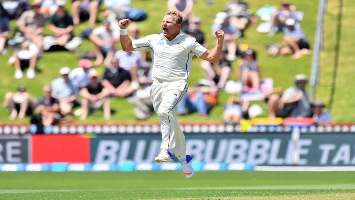 New Zealand's Neil Wagner celebrates West Indies' Kraigg Braithwaite being caught during the first day of the first Test cricket match between New Zealand and the West Indies at the Basin Reserve in Wellington on December 1, 2017. / AFP PHOTO / Marty MELVILLE