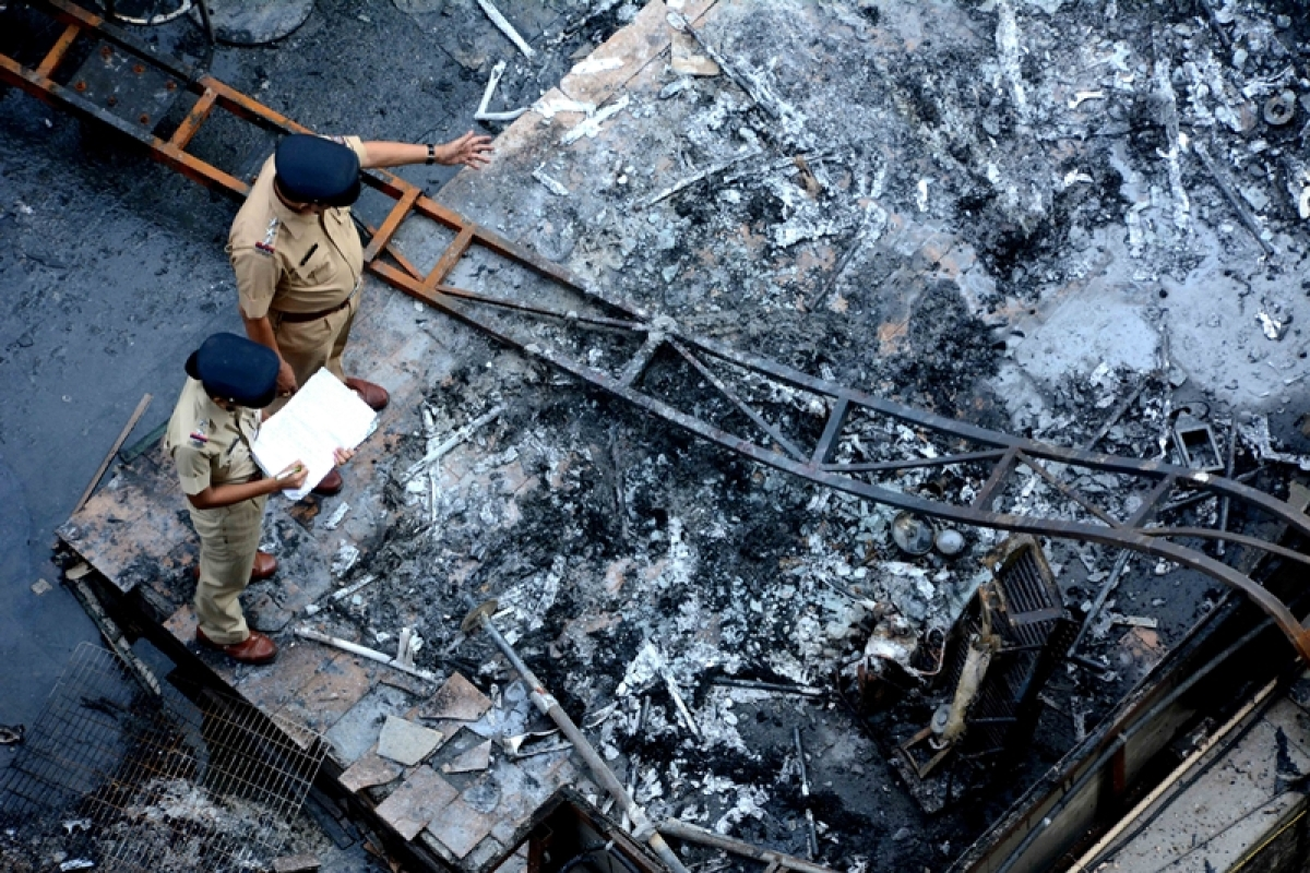 MUMBAI: Fourteen people lost their lives and 21 others were badly injured in a major fire that broke out in a building in Mumbai's Kamala Mills Compound. The blaze, reported around 12.30 a.m. from a rooftop restaurant in The Kamla  Mill .Photo by BL SONI