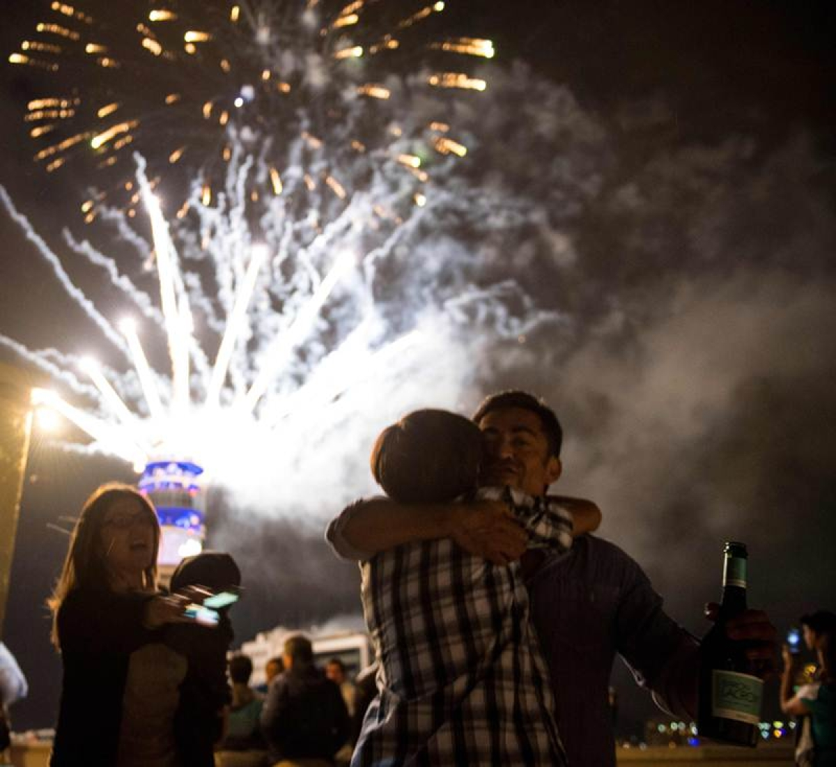 Fireworks illuminate the sky in Santiago during New Year's celebrations on January 1, 2018. / AFP PHOTO / Martin BERNETTI