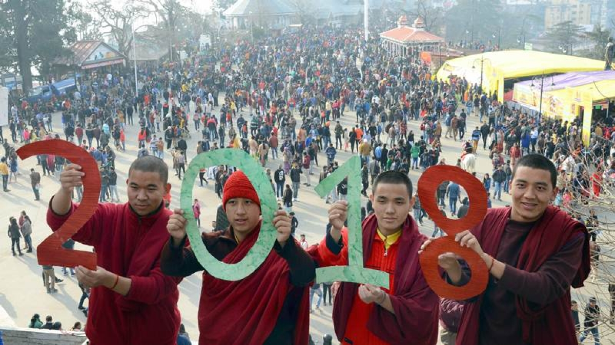 Monks hold cut-outs 0f 2018 to welcome the New Year at Ridge in Shimla on Sunday. PTI Photo