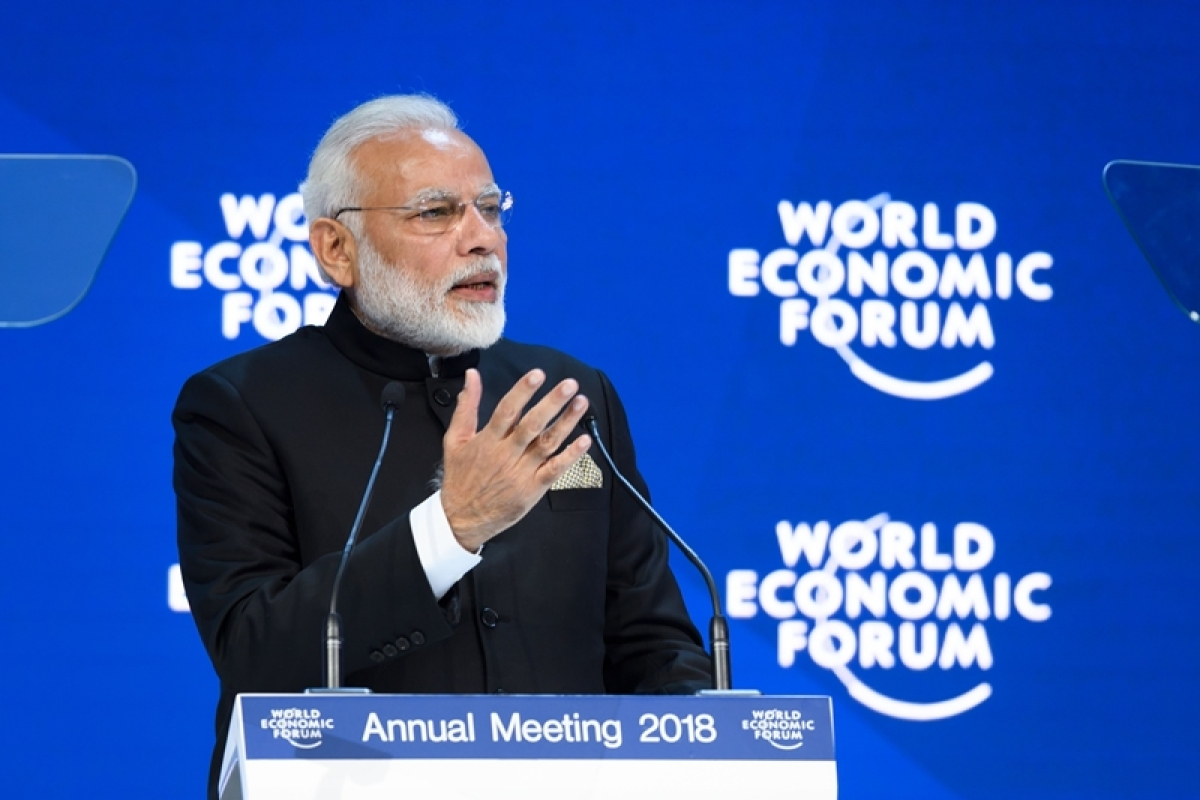 Indian Prime Minister Narendra Modi gestures as he delivers a speech at the opening day the World Economic Forum (WEF) 2018 annual meeting, on January 23, 2018 in Davos, eastern Switzerland. / AFP PHOTO / Fabrice COFFRINI