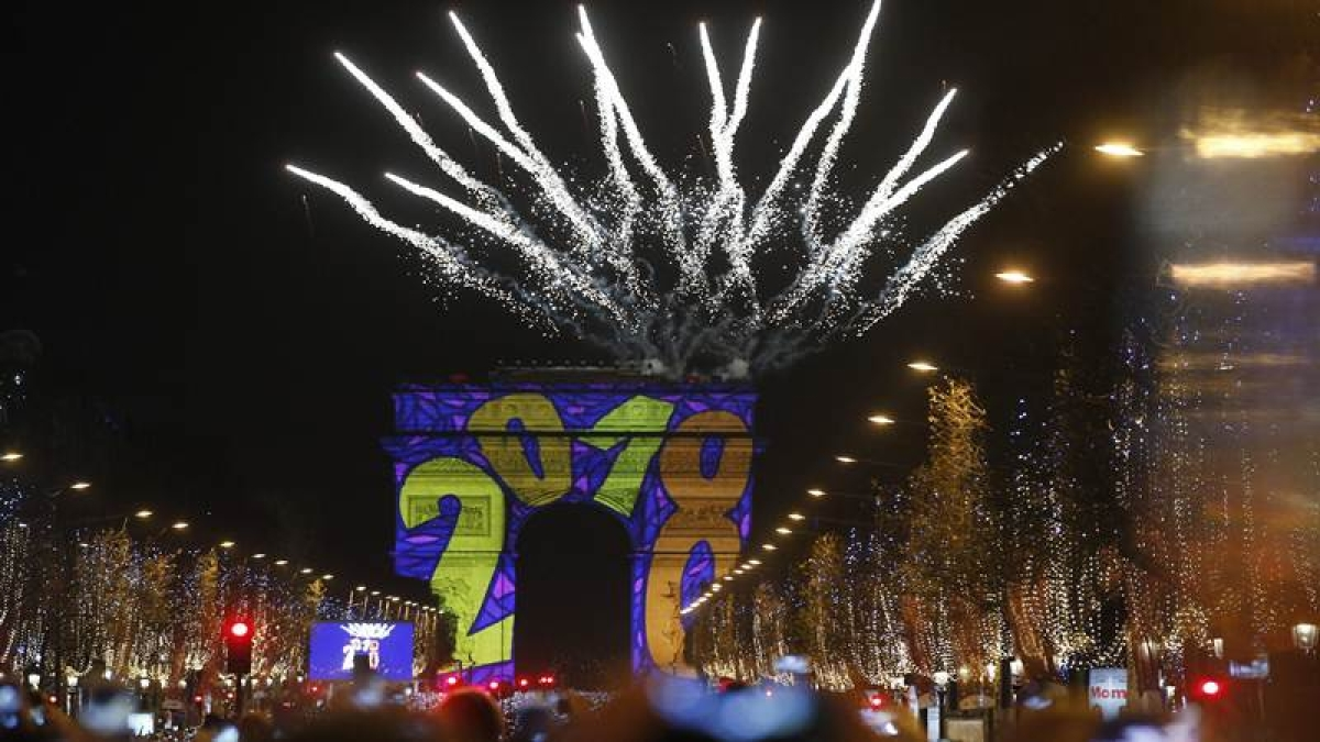 Paris : A firework explodes over the Arc de Triomphe as part of the New Year celebrations on the Champs Elysees, in Paris, France, Monday, Jan. 1, 2018.AP/PTI
