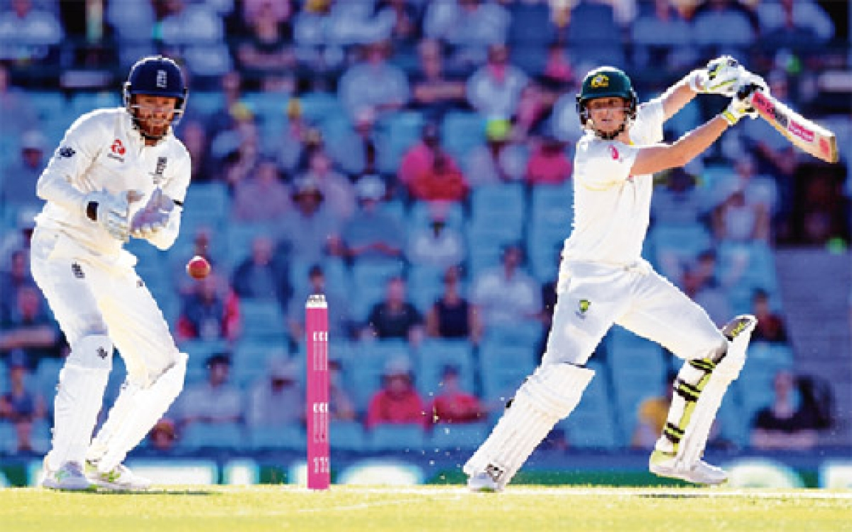 Smith milestone as Aussies chip away at England lead