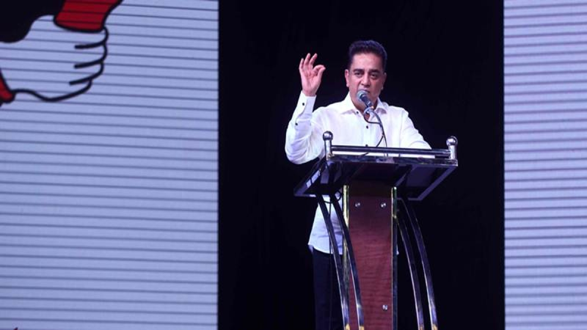 "Kamal Hassan addresses the audience during the launch of his new political party ""Makkal Needhi Mayyam'.  / AFP PHOTO / Arun SANKAR"