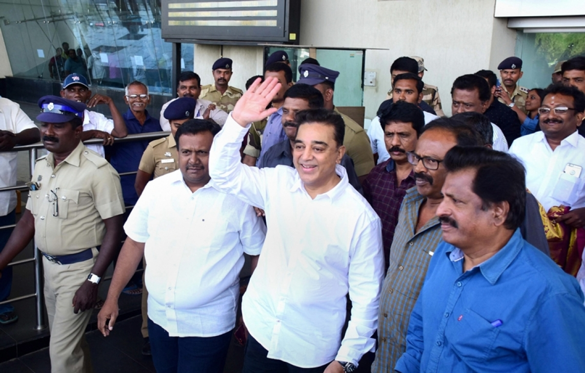 Madurai: Actor Kamal Haasan waves at his supporters on his arrival at the airport in Madurai on Tuesday, a day before he is set to launch his political party. PTI Photo  (PTI2_20_2018_000064B)