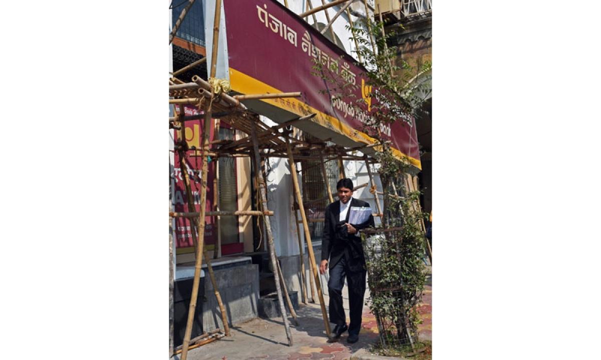 Mumbai: The Punjab National Bank (PNB) branch where fraudulent transcations worth USD 1.77 bn were detected, in Mumbai on Wednesday. PTI Photo by Shashank Parade (PTI2_14_2018_000129B)