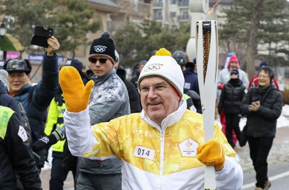 IOC President Thomas Bach carry Olympic torch ahead of PyeongChang Winter Games