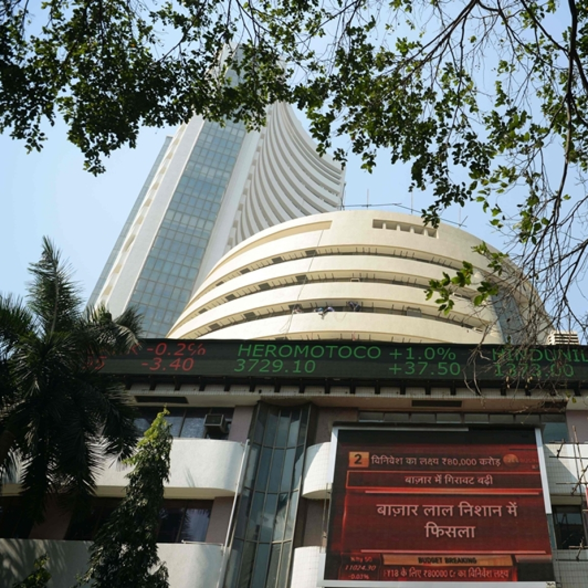Sensex soars past 52,000; Nifty tops 15,300