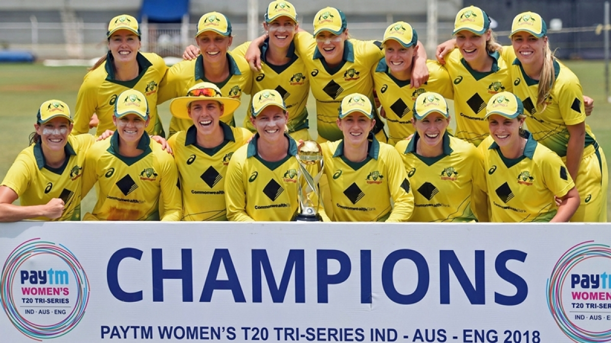 Australian players pose with the winning trophy after defeating England in the Tri-Nation Women's T20I Series final match. PTI Photo by Shashank Parade