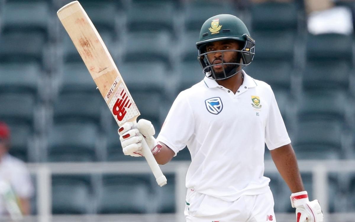 Temba Bavuma celebrates scoring half century (50 runs) on the second day of the fourth Test match against Australia. / AFP PHOTO / GIANLUIGI GUERCIA