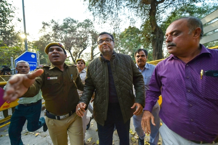 Karti Chidambaram escorted by police personnel to the Patiala House court. PTI photo by Arun Sharma