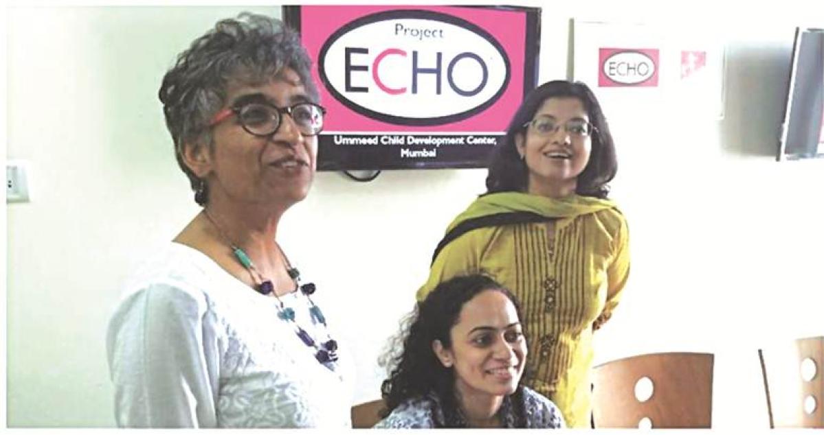 Dr Vibha Krishnamurthy (left) with volunteers