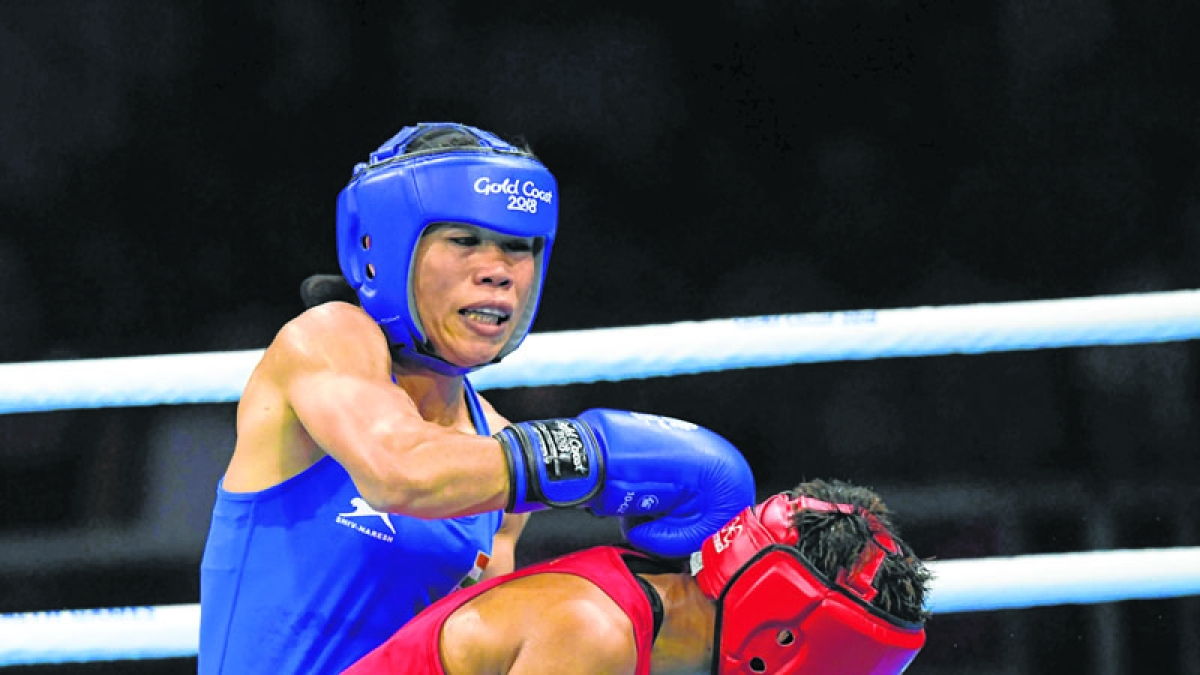 India's Mary Kom (in blue)