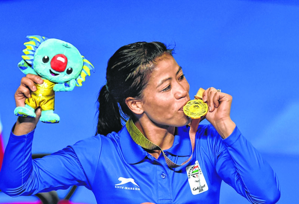 Gold Coast: Gold medalist India's MC Mary Kom during the medal ceremony of the women's Light Fly (45-48kg) boxing event at the Commonwealth Games 2018 in Gold Coast, Australia on Saturday. PTI Photo by Manvender Vashist  (PTI4_14_2018_000036B)