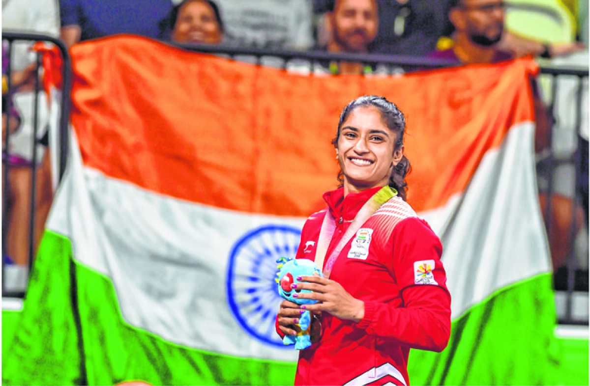 EDS PLS TAKE NOTE OF THIS PTI PICK OF THE DAY::::::::: Gold Coast: Gold medalist India's Vinesh Phogat poses for pictures during the medal ceremony of WFS50kg wrestling Nordic at the Commonwealth Games 2018 in Gold Coast, Australia on Saturday. PTI Photo by Manvender Vashist   (PTI4_14_2018_000079A)(PTI4_14_2018_000232B)