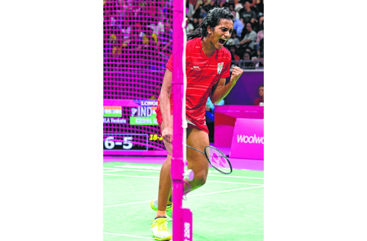 India's Venkata Pusarla reacts after a point against India's Saina Nehwal in the badminton women's singles final at the 2018 Gold Coast Commonwealth Games in Gold Coast on April 15, 2018. / AFP PHOTO / Saeed KHAN