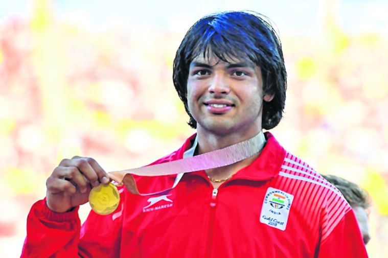 India's Neeraj Chopra (gold) poses with his medal after the athletics men's javelin throw final during the 2018 Gold Coast Commonwealth Games at the Carrara Stadium on the Gold Coast on April 14, 2018. / AFP PHOTO / SAEED KHAN