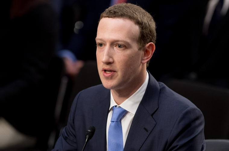 Facebook founder and CEO Mark Zuckerberg testifies during a Senate Commerce, Science and Transportation Committee and Senate Judiciary Committee joint hearing about Facebook on Capitol Hill in Washington, DC, April 10, 2018. Facebook chief Mark Zuckerberg apologized to US lawmakers Tuesday for the leak of personal data on tens of millions of users as he faced a day of reckoning before a Congress mulling regulation of the global social media giant.In his first-ever US congressional appearance, the Facebook founder and chief executive sought to quell the storm over privacy and security lapses at the social network that have angered lawmakers and Facebook's two billion users.  / AFP PHOTO / SAUL LOEB