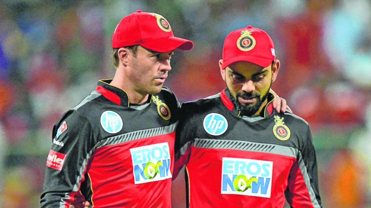 RCB captain Virat Kohli (R) and AB De Villiers .