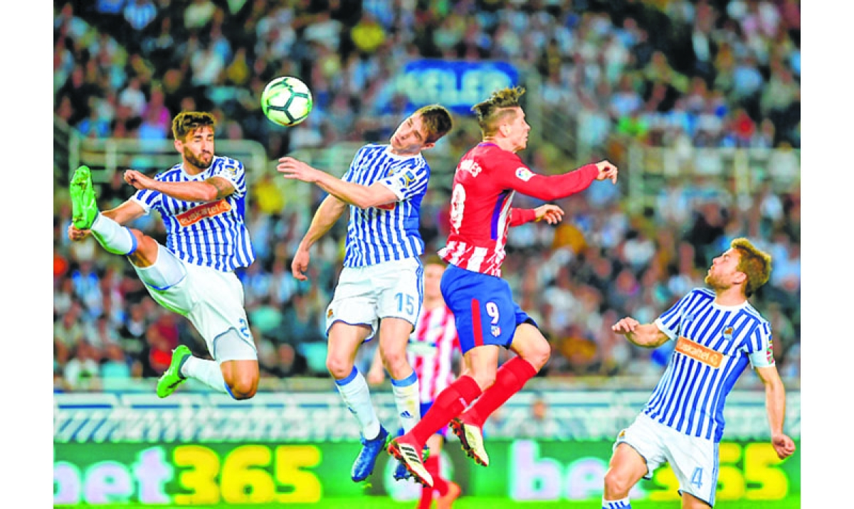 Juanmi double blows hole in Atletico Madrid title hopes