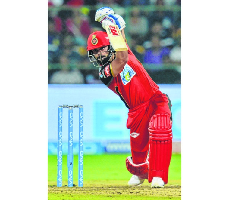 Royal Challengers Bangalore batsman and captain Virat Kohli plays a shot during the 2018 Indian Premier League (IPL) Twenty20 cricket match between Royal Challengers Bangalore and Kolkata Knight Riders at the M. Chinnaswamy Stadium in Bangalore on April 29, 2018.  / AFP PHOTO / Manjunath KIRAN / ----IMAGE RESTRICTED TO EDITORIAL USE - STRICTLY NO COMMERCIAL USE----- / GETTYOUT