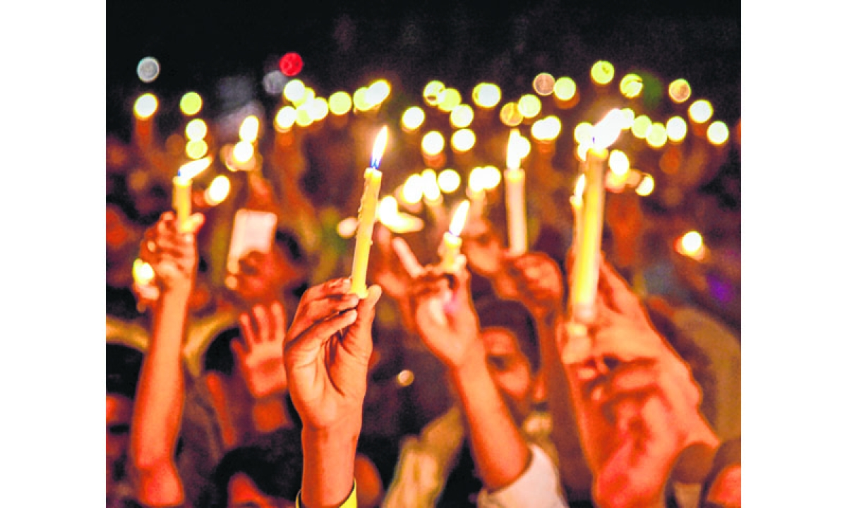 Bikaner: Youth take part in a candlelight march over Unnao and Kathua rape cases, in Bikaner on Friday night. PTI Photo    (PTI4_14_2018_000057B)