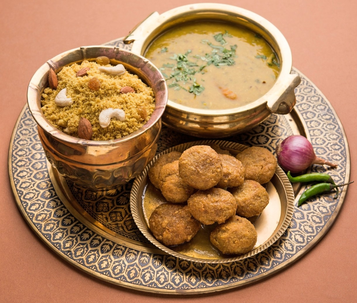 Baati and spicy dal with sweet churma