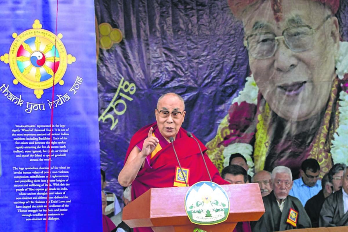 "Tibetan spiritual leader the Dalai Lama addresses a gathering during the "" Thank you India-2018"" function at Tsugla Khang Temple in Dharamshala on March 31, 2018. / AFP PHOTO / Shailesh Bhatnagar"