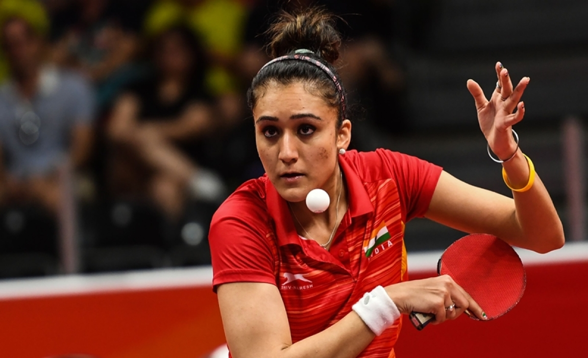 India's Manika Batra serves during the women's singles semi-final table tennis match. / AFP PHOTO / YE AUNG THU