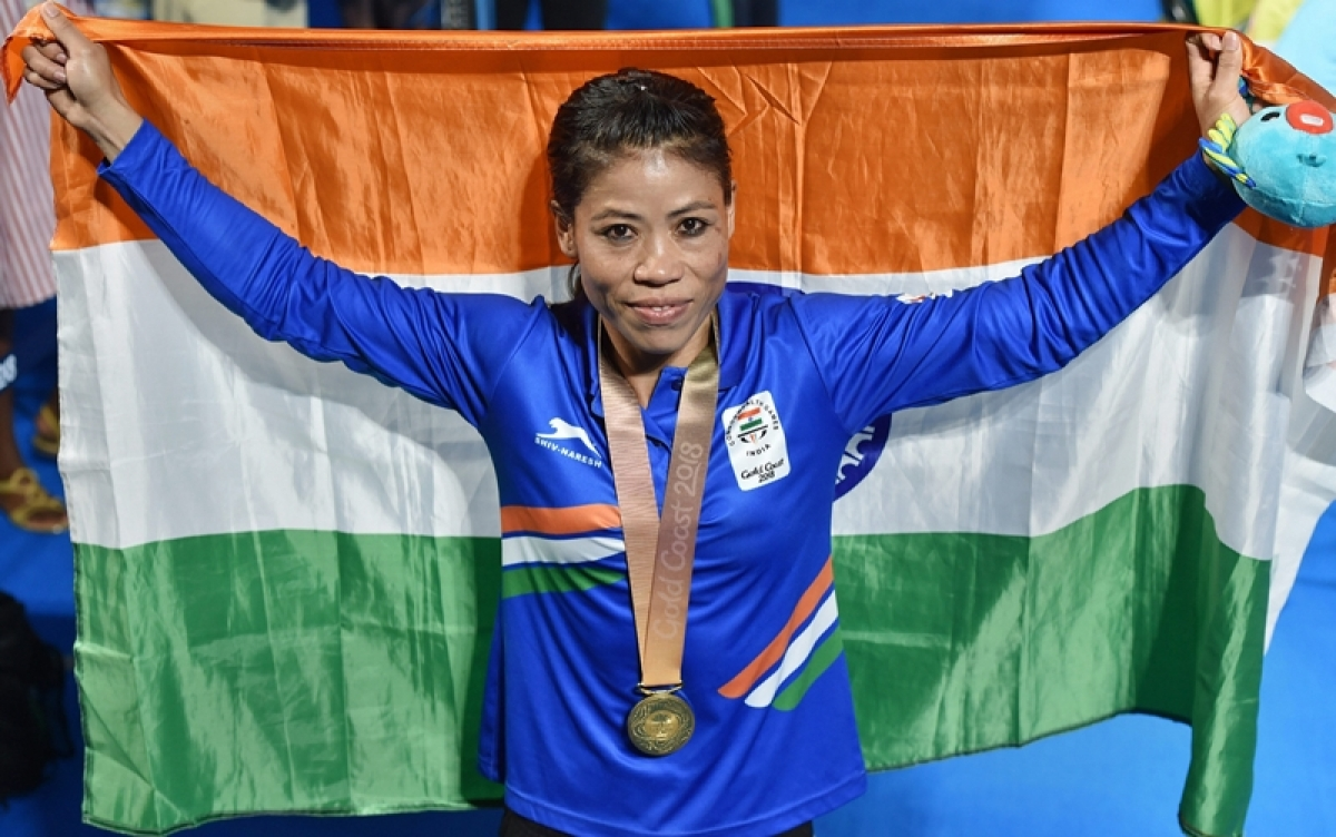 Gold medalist MC Mary Kom during the medal ceremony of the women's Light Fly (45-48kg) boxing event. PTI Photo by Manvender Vashist