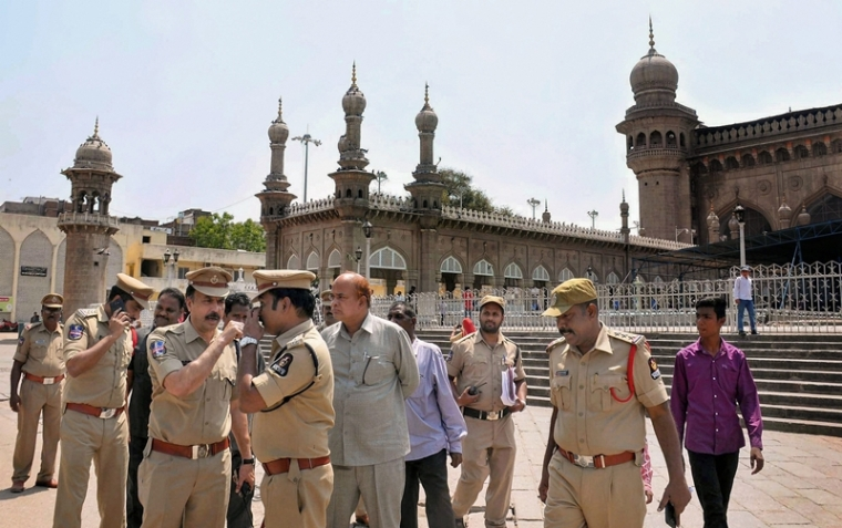 Hyderabad: South Zone DCP V Satyanarayana along with other officials at the historic Mecca Masjid in old city of Hyderabad on Monday. A Special NIA court on Monday acquitted all accused in 2007 Mecca Masjid blast case. PTI Photo (PTI4_16_2018_000075B)