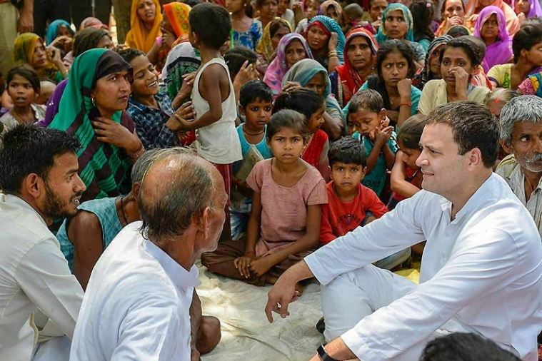 Amethi: Congress President Rahul Gandhi meets with farmers at a 'chaupal' at Urer Mau village in his parliamentary constituency Amethi on Monday. PTI Photo  (PTI4_16_2018_000103B)