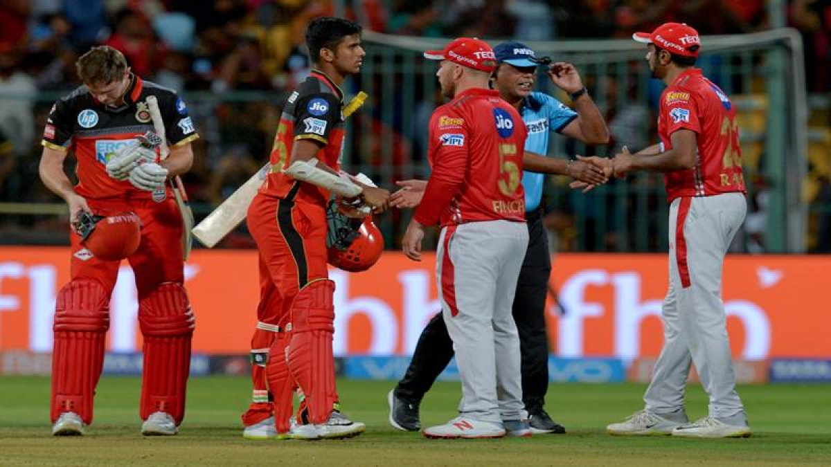 KXIP player (2R) greet RCB batsmen after RCB won the match with 4 wickets in hand during the 2018 Indian Premier League (IPL) Twenty20 cricket match between Royal Challengers Bangalore and Kings XI Punjab at The M. Chinnaswamy Stadium in Bangalore on April 13, 2018.  RCB chased a target of 156 runs scored by KXIP. / AFP PHOTO / Manjunath KIRAN / ----IMAGE RESTRICTED TO EDITORIAL USE - STRICTLY NO COMMERCIAL USE----- / GETTYOUT