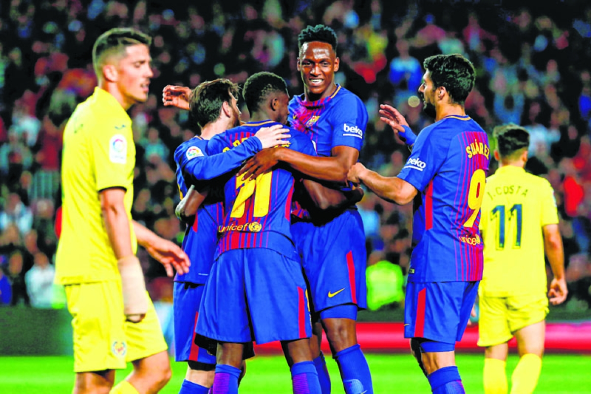 Dembele edges Barca closer to unbeaten season; Real stumbles