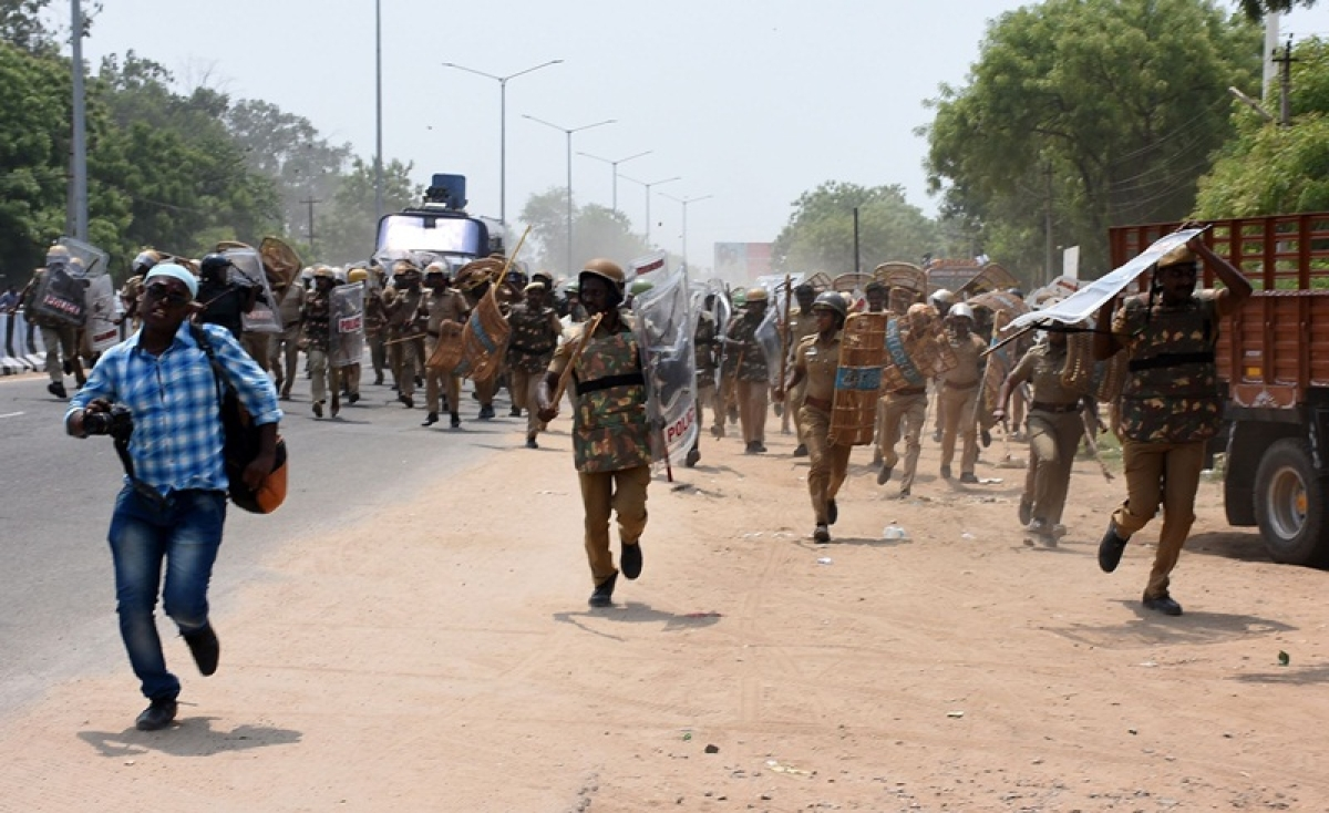 Indian police officials charge towards protestors in the southern Indian city of Tuticorin some 600 kilometres (375 miles) south of Chennai on May 22, 2018, during a protest rally held to demand the closure of a copper factory due to pollution concerns.   FILE  / AFP PHOTO / ARUN SANKAR