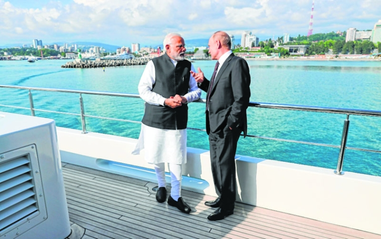 Sochi :  Russian President Vladimir Putin, right, speaks to Indian Prime Minister Narendra Modi during a boat ride after their talks in the Bocharov Ruchei residence in the Black Sea resort of Sochi, Russia, Monday, May 21, 2018. AP/ PTI(AP5_21_2018_000228B)