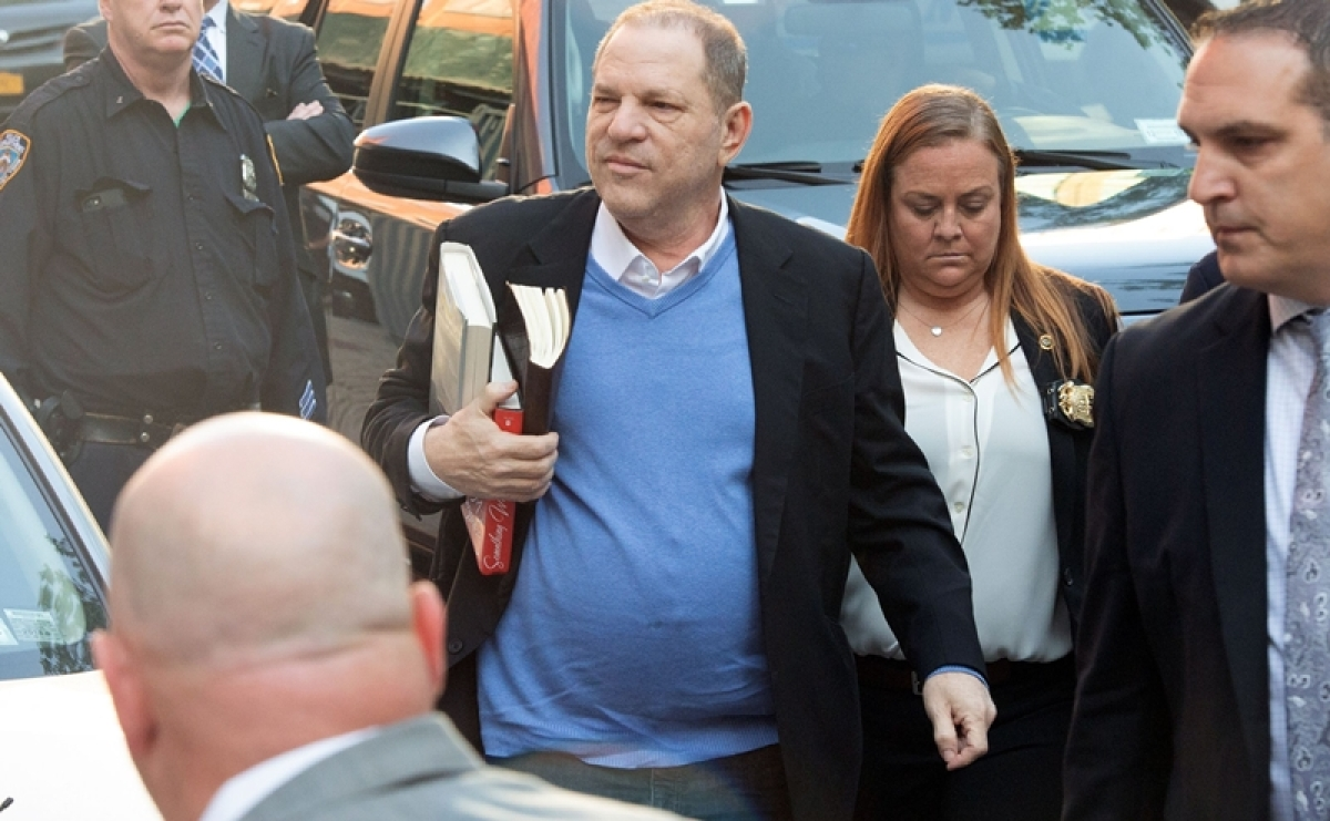 Harvey Weinstein surrenders to New York police to face sexual assault charges