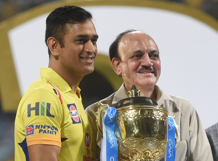Mumbai: Chennai Super Kings captain M S Dhoni receives IPL 2018 trophy from C K Khanna, acting president BCCI after winning the final match against Sunrisers Hyderabad, in Mumbai on Sunday. CSK defeated SRH by eight wickets to lift the trophy. (PTI Photo/Shashank Parade)  (PTI5_27_2018_000205B)