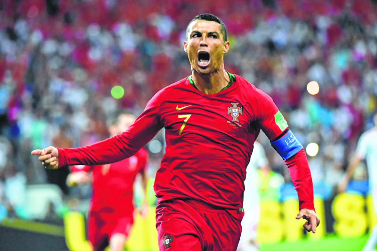 Ronaldo toasts new career mark after hat-trick against Spain