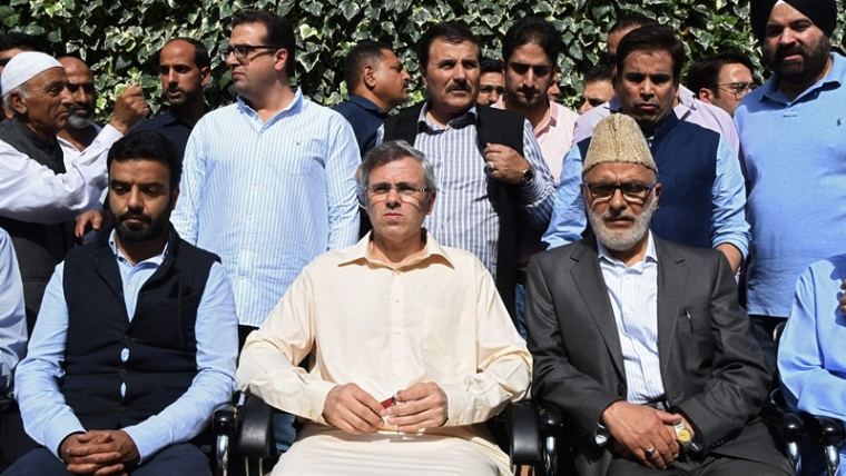 National Conference party leader and former chief Minister Omar Abdullah (sitting C)