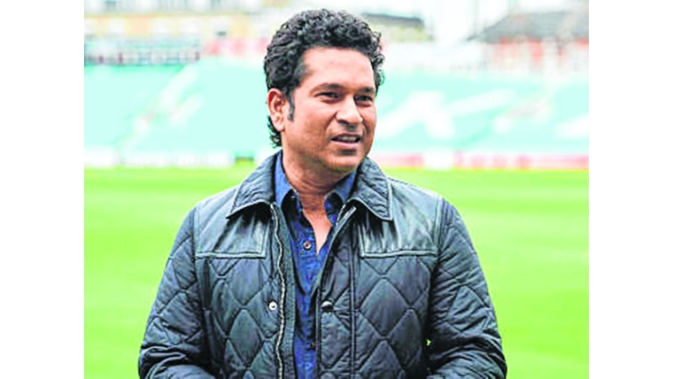 "Indian cricket legend Sachin Teldulkar poses for a photograph during a photocall at the Oval cricket ground in south London on May 6, 2017, promoting the upcoming release of his film, ""Sachin: A Billion Dreams"".    / AFP PHOTO / Niklas HALLE'N"