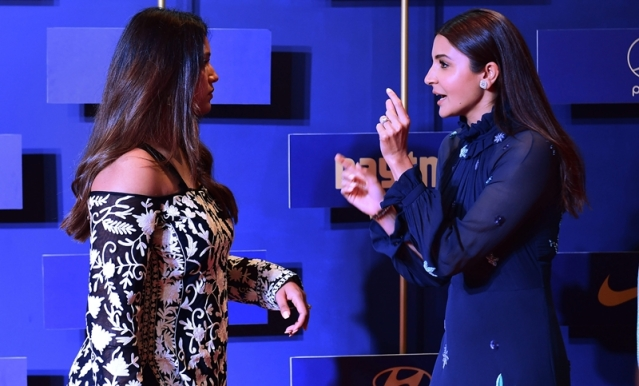 Indian cricket wicketkeeper Dinesh Karthick's wife Dipika Pallikal talks to Bollywood actor Anushka Sharma during the BCCI annual awards, in Bengaluru. PTI Photo/Shailendra Bhojak