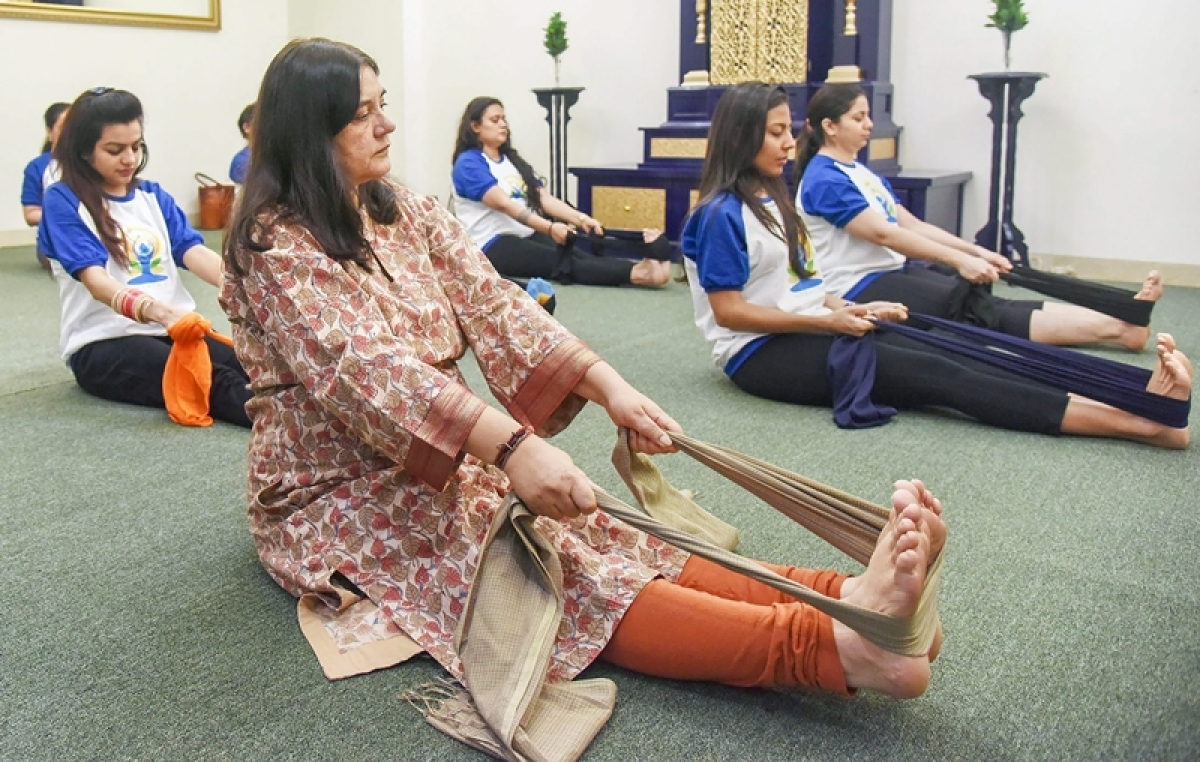 International Yoga Day 2018: Maneka Gandhi performs prenatal yoga asanas with pregnant women