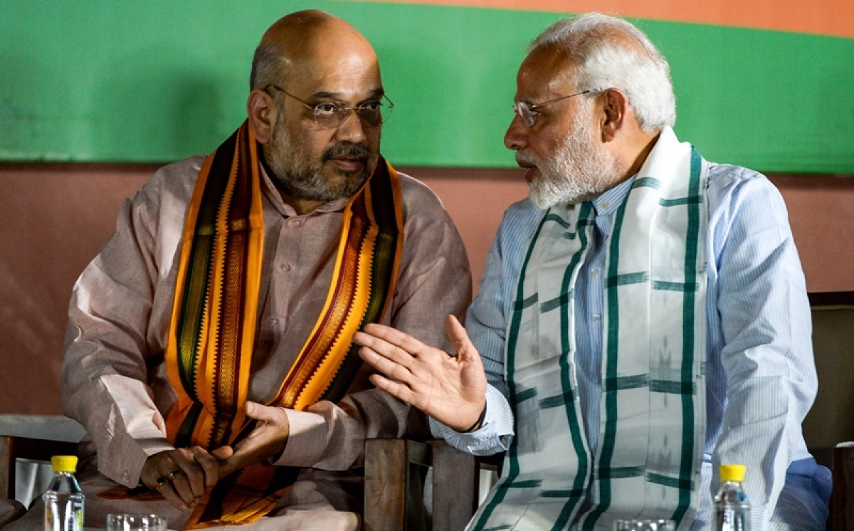 Prime Minister Narendra Modi (R) and BJP President Amit Shah. File Pic/ AFP