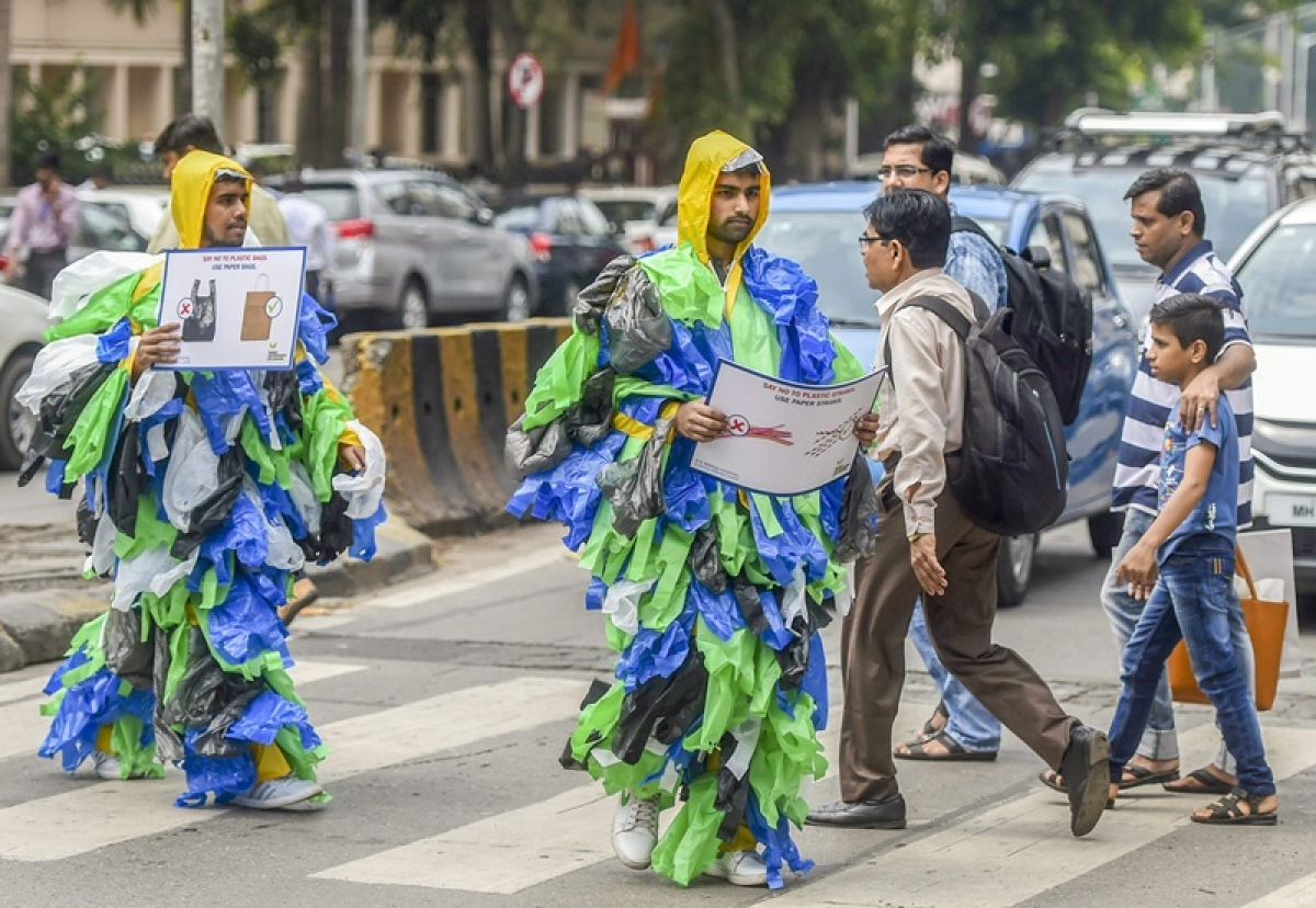 Mumbai: Volunteers, wearing costumes made up of plastic bags, aware people against the use of plastic bags, on the occasion of World Environment Day, in Mumbai on Tuesday, June 05, 2018. (PTI Photo/ Shashank Parade)(PTI6_5_2018_000053B)