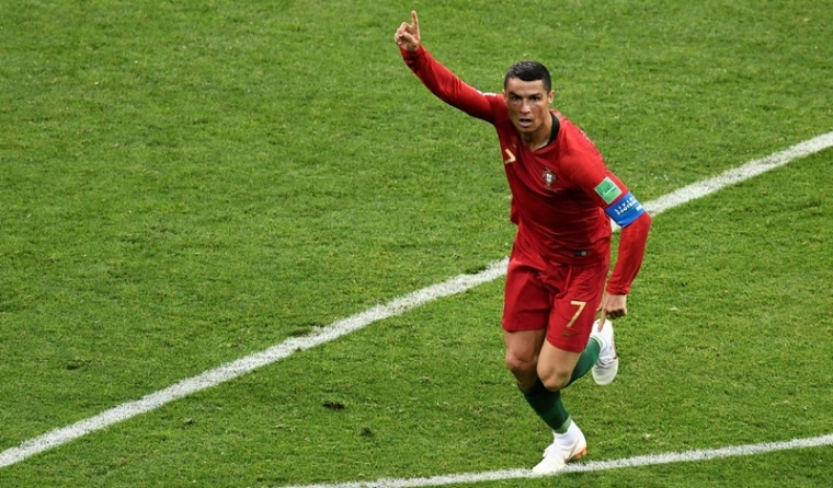 Cristiano Ronaldo celebrates during the Russia 2018 World Cup Group B football match against Spain. / AFP PHOTO / Jonathan NACKSTRAND